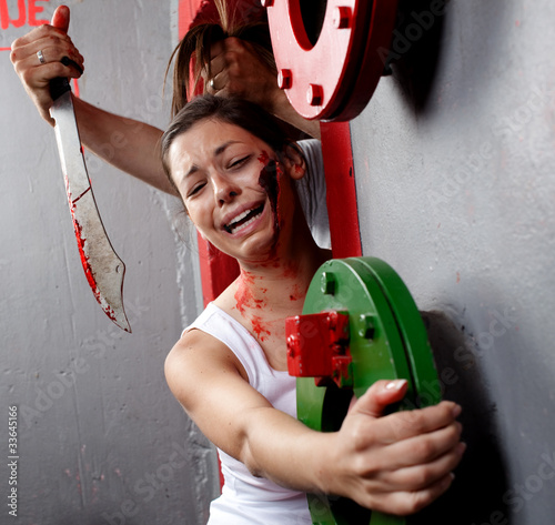 Terrified young woman clinging on for her life