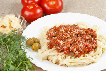 Italian cuisine. Pasta with meat sauce
