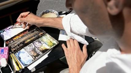 artista di strada, acquerellista