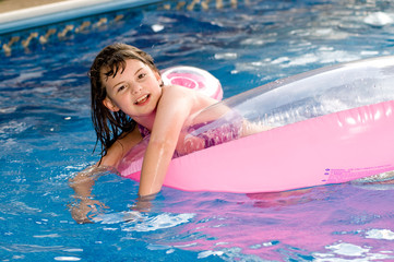 picture of a young girl playing in a pool