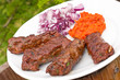 Cevapcici with ajvar paste and red onion