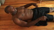 Sit ups in slow motion on hardwood floor