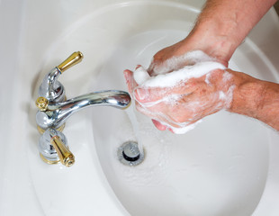 Senior male wash hands with soap