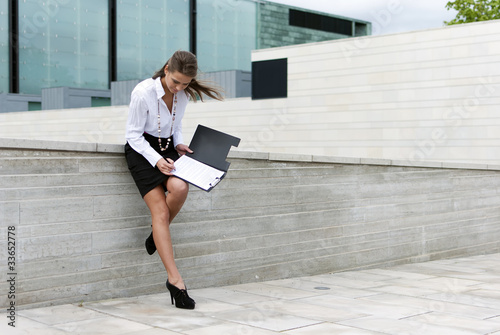 business woman sign documents