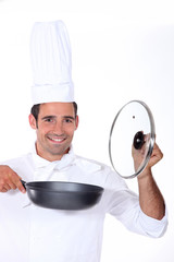 Chef holding a deep pan and glass lid