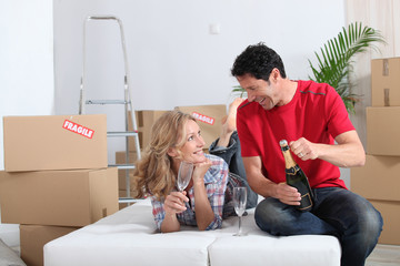 Couple celebrating their new home with champagne