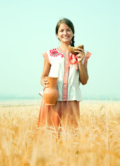 Girl with bread  at rye field