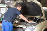 Mechanic using laptop