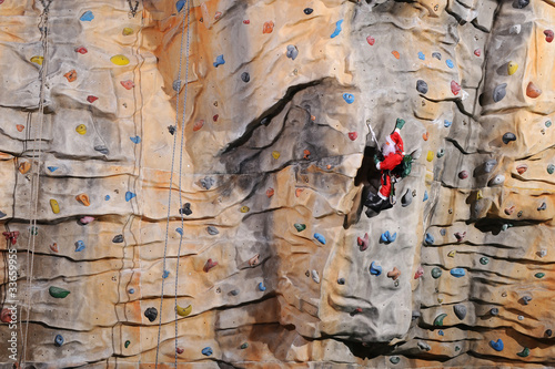Santa Claus on rock wall