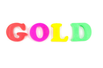 gold written in child's fridge magnets on white
