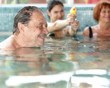 Generations having fun at swimming pool
