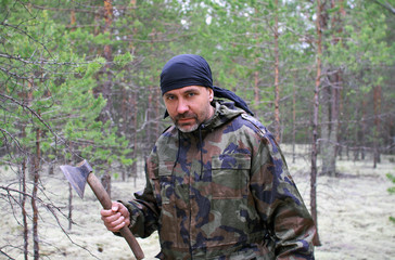 Man with an ax in the forest