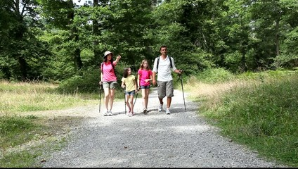 Family hiking in forest countrypath