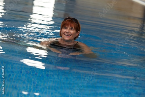 Happy mature woman in swimming pool