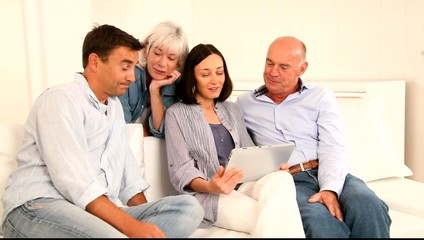 Parents and grandparents using electronic tablet