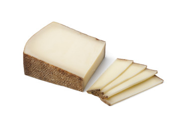 Piece of Swiss Gruyere cheese ans slices