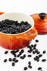 Black beans in bowl isolated on white