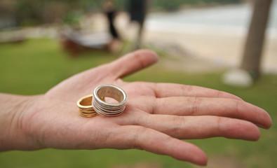 Wedding ring on nice palm