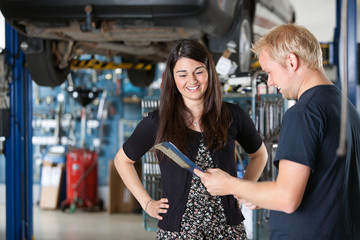 Happy Female Customer at Mechanic