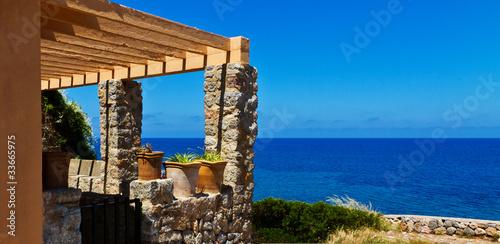 Fotobehang Tuin Haus am Meer