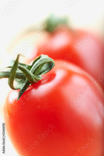 cherry tomatoes on a white background, shallow deep of field