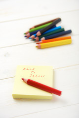 pencil and postit with back to school text