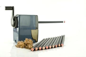 A pencil sharpener and pencil row