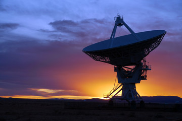 Radio telescope at the Very Large Array (VLA), USA, at sunset