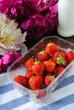 Strawberries, milk, flowers