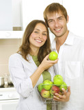Happy Family Eating Apples. Healthy Eating concept. Diet