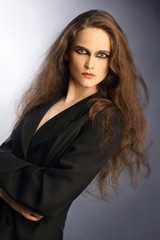 Portrait of beautiful woman with long thick brown hair