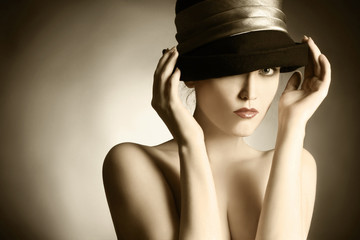 Fashion portrait of retro woman in elegant hat.