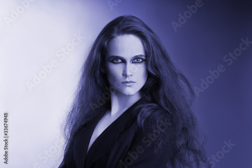 Blue artistic portrait of attractive beautiful woman