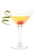 Yellow banana martini cocktail in martinis glass with lime twist