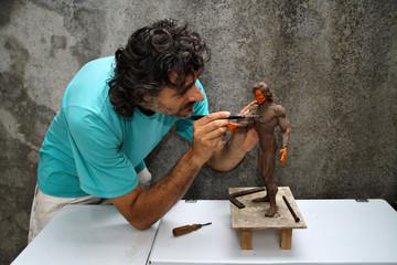 artist working on a figurine