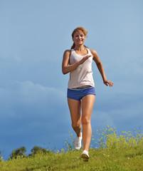 running girl on green grass