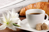 Fototapety Breakfast with newspaper, croissant and coffee