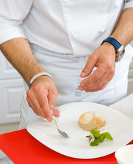 chef decorate plate with dessert