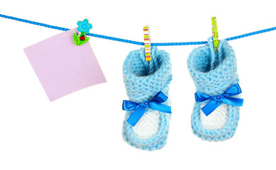 baby booties hanging on a clothes line