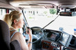 Blonde woman truck driver talking on her radio. - 33693769