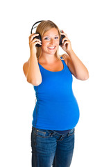 Pregnant woman with headphones isolated on white