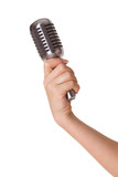 Microphone in female hand isolated on white
