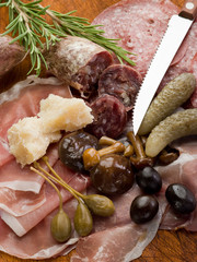 italian appetizer with salami, grana,speck,mushroom,cucumber