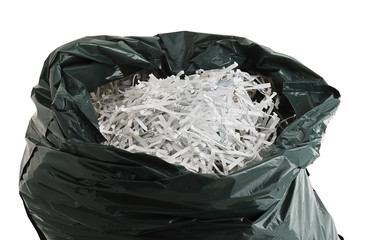 Plastic bag filled with shredded paper