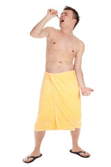 shaving young man in yellow towel with razor