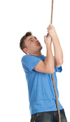 young man in blue casual shirt climbing on rope