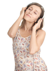 young girl listening music from mp3 player