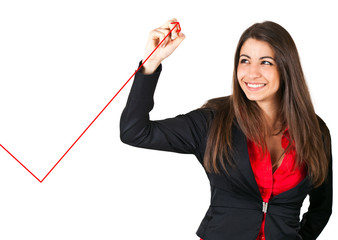 Businesswoman drawing a rising arrow