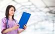 Nurse reading a clipboard