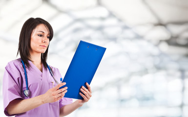 Nurse reading a clipboard